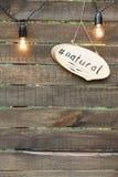Une inscription écrite dans un morceau de bois ovale Photographie stock