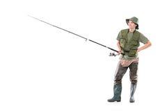 Une jeune attente de pêcheur Photo libre de droits