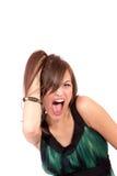Une jeune femme heureuse avec l'expression faciale Photo stock