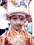 Une jeune fille dans le festival des vaches-Gaijatra Images libres de droits