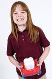 Jeune fille de caucasion attendant sur la fée de dent Photographie stock libre de droits