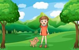 Une jeune fille et son chiot à la colline Photo stock