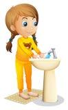Une jeune fille mignonne se lavant les mains illustration de vecteur
