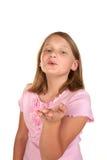 Une jeune fille soufflant un baiser images stock