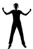Une jeune silhouette de garçon ou de fille d'adolescent heureuse Photographie stock libre de droits