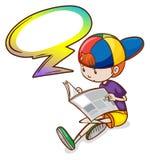 Une lecture de garçon avec une légende vide Image stock