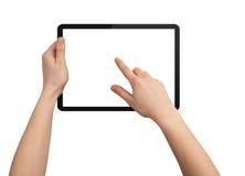 Une main mâle retenant un PC de touchpad Images libres de droits