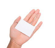 Une main tenant une carte/note de livre blanc sur la paume Photographie stock