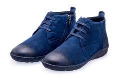 Une paire de chaussures bleues de sports avec la dentelle Image libre de droits
