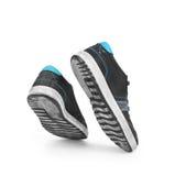 Une paire de chaussures dans un saut Photos libres de droits