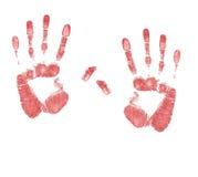 Une paire de sang a souillé des impressions de main Image stock