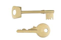 Une paire de vieilles clés sur le fond blanc Image stock