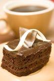 Une part de gâteau et de café Images stock
