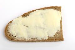 Une part de pain avec du beurre Photographie stock