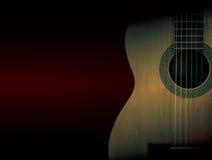 Une partie d'une guitare acoustique orange sur le fond noir Images libres de droits