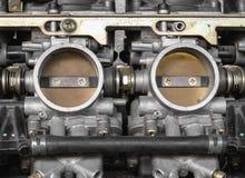 Une partie de carburateur pour la moto Images stock