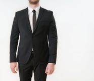 Une partie de corps d'homme d'affaires dans le costume noir photographie stock