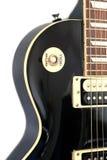 Une partie de guitare électrique de couleur noire Image libre de droits