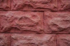 Une partie de la base Mur en pierre rouge image libre de droits