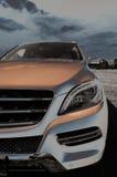 Une partie de Mercedes ml, nouveau SUV, phares, 2013 Image stock