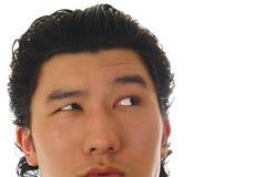 Une partie de visage asiatique d'homme Photos stock