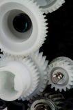 Une partie de vitesses en plastique blanches Images stock