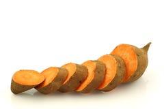 Une patate douce de coupure Photo stock