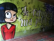 Une peinture murale gentille se vend avec un message de l'amour Photos libres de droits