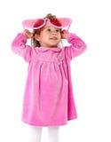 Une petite fille avec de grandes glaces roses Photos libres de droits