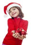Une petite fille avec un capuchon de Santa Photo libre de droits