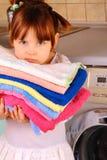 Une petite fille va laver Photo stock