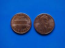 Une pièce de monnaie d'USD de cent du dollar, Etats-Unis Etats-Unis au-dessus de bleu Photo libre de droits