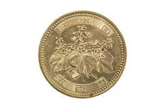 Une pièce de monnaie de Yens japonais d'isolement sur le fond blanc Photo libre de droits