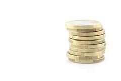 Une pile d'or et d'euro pièces de monnaie argentées Image stock