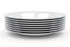 Une pile de plats sur un fond blanc Image stock