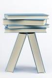 Une pile de quelques livres bleus fermés Photographie stock libre de droits