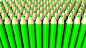Une pile du crayon 3d vert sur un fond blanc Photos libres de droits