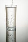 Une pleine glace d'eau Images stock