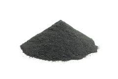 Une poignée de charbon de bois en poudre Photos stock
