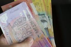Une poignée de mony de papier australien images stock