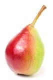 Une poire rouge-jaune sur le fond blanc Image stock