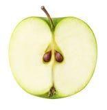 Une pomme de coupe de vert d'isolement sur le fond blanc Photographie stock libre de droits