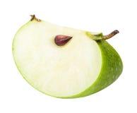 Une pomme de coupe de vert d'isolement sur le fond blanc Image libre de droits
