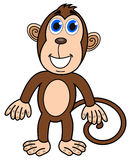 Une position heureuse de singe Photographie stock libre de droits