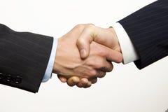 Une prise de contact d'affaires avec le fond blanc photographie stock libre de droits