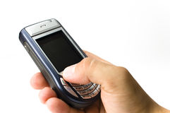Une prise de main un combiné téléphonique Photo stock