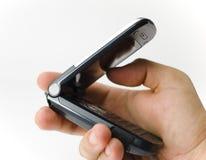 Une prise de main un combiné téléphonique Photos libres de droits