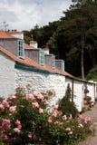 Une rangée de vieux cottages Photographie stock libre de droits