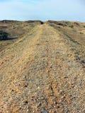 Route rugueuse Image libre de droits