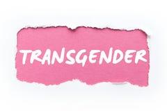"""Une rupture du livre blanc, l'inscription """"transsexuel """"sur un fond rose images stock"""